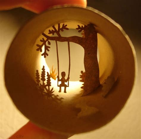 Paper cut collages inside toilet paper rolls by Anastassia