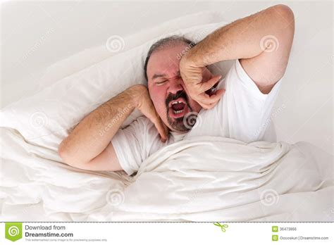 Tired Man Stretching In An Effort To Wake Up Stock Photo