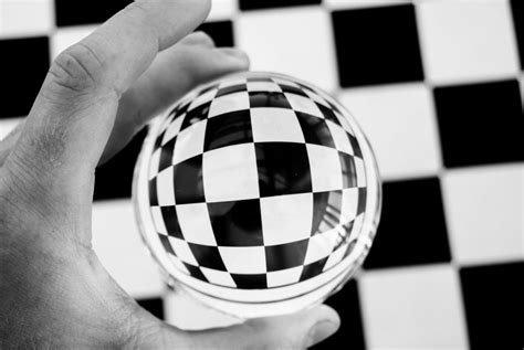 A black and white photography of chess board tiles